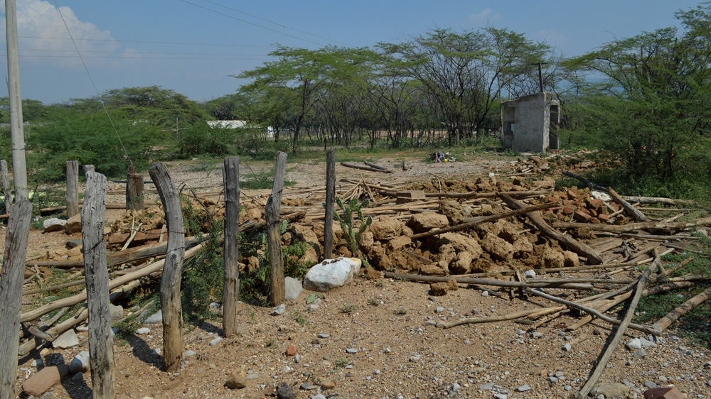 Remains of demolished houses are everywhere in Las Casitas. Since Cerrejon asked the residents to move out of the village in 2009, the majority of the people have left [Fredrik Brogeland Laache/Al Jazeera]