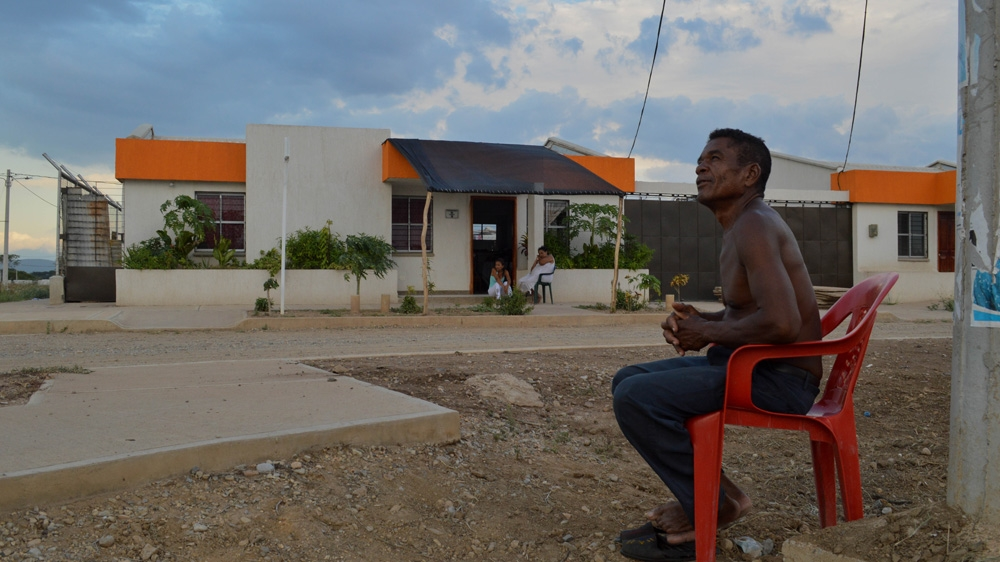 Alonso Rafael Molina, 61, relocated to Las Nuevas Casitas with his wife and five children last year. He complains about the lack of work in his new urban village [Fredrik Brogeland Laache/Al Jazeera]